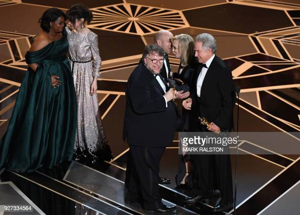 Mexican director Guillermo del Toro and producer J Miles Dale accept the Oscar for Best Film for 'The Shape of Water' from US actors Faye Dunaway and...