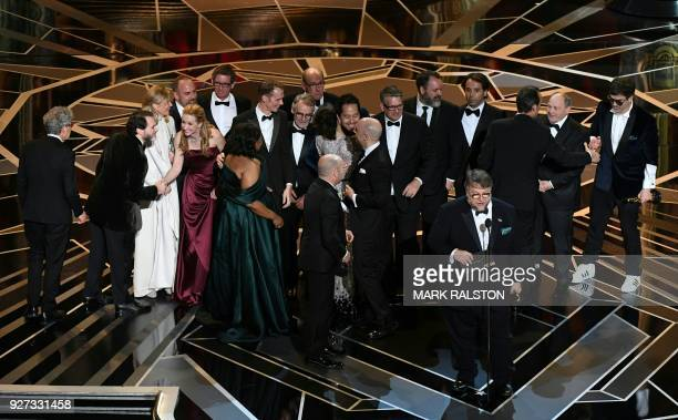 Mexican director Guillermo del Toro delivers a speech on stage in front of his cast and crew after he won the Oscar for Best Film for 'The Shape of...