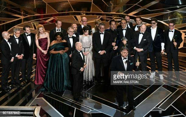 Mexican director Guillermo del Toro delivers a speech surrounded by his cast and crew after he won the Oscar for Best Film for 'The Shape of Water'...