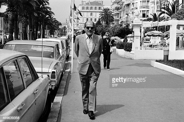 Mexican director Luis Bunuel walks on the Croisette in Cannes during the Film Festival in May 1972 Born in 1900 in Calanda Spain Luis Bunuel settled...