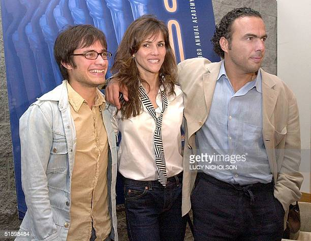 Mexican director of 'Amores Perros' Alejandro Gonzalez Inarritu poses with the film's stars Spanish actress Goya Toledo and Mexican actor Gael Garcia...