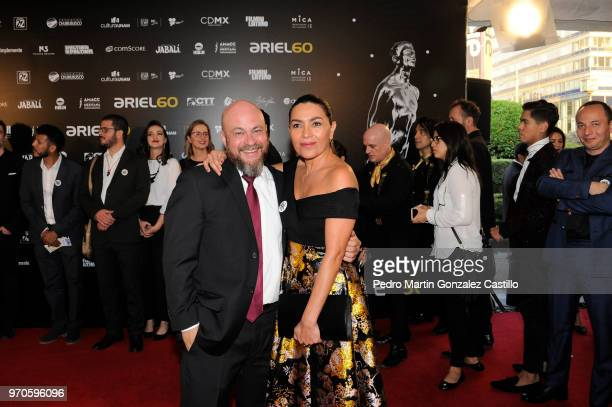 Mexican documentalist Everardo González and mexican actress Dolores Heredia pose during the Red Carpet of 60th Ariel Awards at Palacio de Bellas...