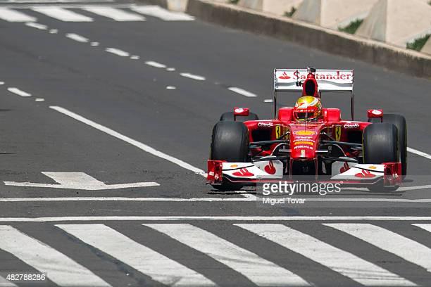 Mexican driver of F1 Esteban Gutierrez drives during the Scuderia Ferrari Street Demo at Reforma Avenue on August 02 2015 in Mexico City Mexico