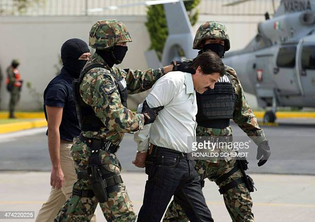 Mexican drug trafficker Joaquin Guzman Loera aka 'el Chapo Guzman' is presented to the press on February 22 2014 in Mexico City The Sinaloa cartel...