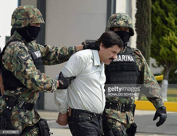 Mexican drug trafficker Joaquin Guzman Loera aka el Chapo Guzman is escorted by marines as he is presented to the press on February 22 2014 in Mexico...