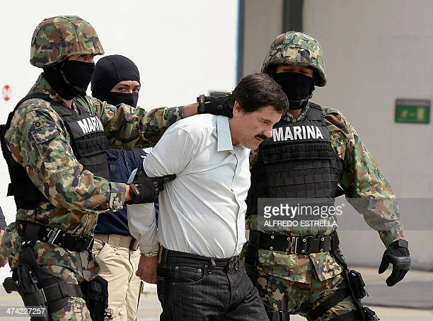 """Mexican drug trafficker Joaquin Guzman Loera aka """"el Chapo Guzman"""" , is escorted by marines as he is presented to the press on February 22, 2014 in..."""