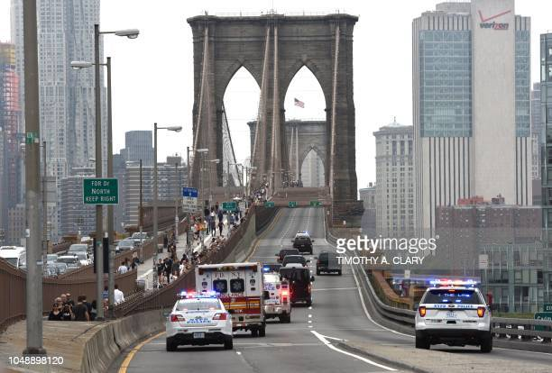 Mexican drugs kingpin Joaquin 'El Chapo' Guzman is escorted by police motorcade across the Brooklyn Bridge on October 10 back to jail in lower...