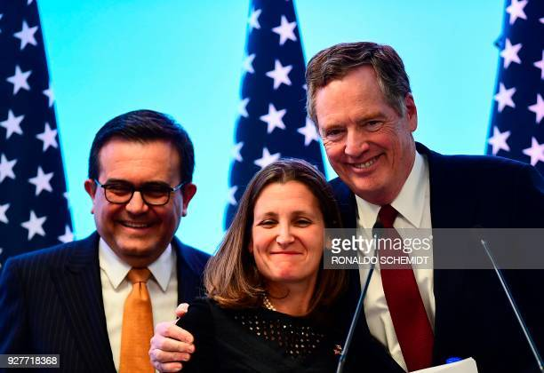 Mexican Economy Minister Idelfonso Guajardo Canadian Minister of Foreign Affairs Chrystia Freeland and US Trade Representative Robert Lighthizer pose...