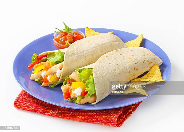 mexican fajitas (tortilla wraps) on a blue plate