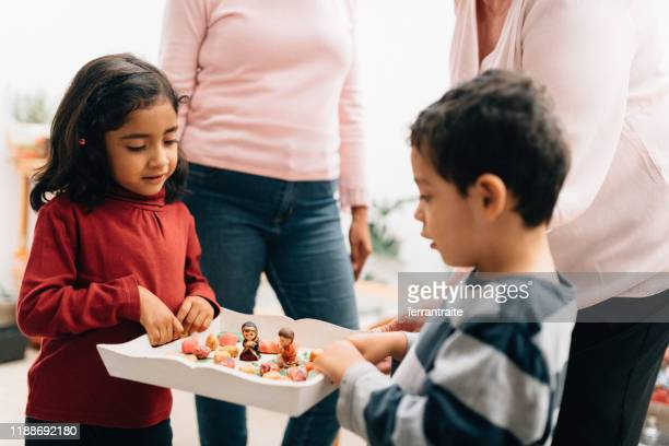 mexican family doing las posadas. nativity scene - madonna singer stock pictures, royalty-free photos & images