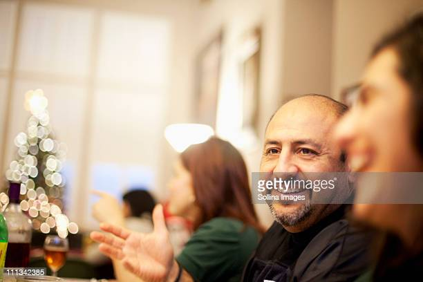 mexican family enjoying each other's company - balding stock pictures, royalty-free photos & images