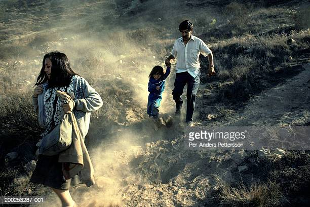mexican family runs over the border illegally into the united states in san diego, california - climate refugees stock pictures, royalty-free photos & images