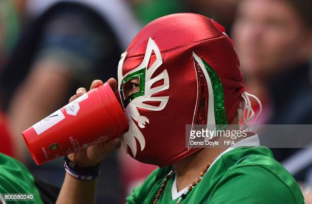 Mexican fan enjoys a refreshment while watching the Group A FIFA Confederation Cup match between Mexico and Russia at Kazan Arena on June 24 2017 in...
