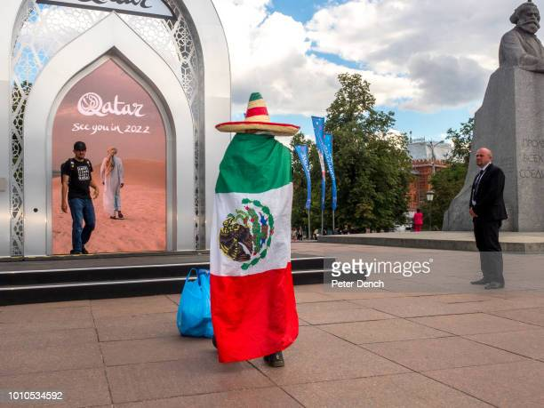 Mexican fan in front of an installation advertising the next FIFA World Cup in Qatar located next to a monument of Karl Marx in central Moscow Karl...