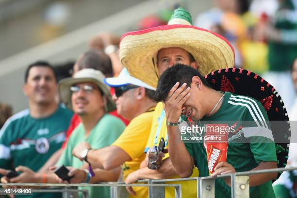 Mexican fan shows his dispair after the 2014 FIFA World Cup Brazil Round of 16 match between Netherlands and Mexico at Castelao on June 29 2014 in...