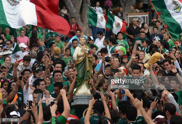 Mexican fans gather to celebrate Mexico's victory against Germany during the 2018 World Cup in Merida Yucatan state Mexico on June 17 2018