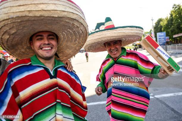 Mexican fans pose for picture during the opening ceremony of the FIFA Fan Fest in Nizhny Novgorod on June 14 during the Russia 2018 World Cup