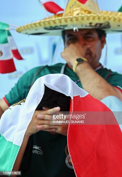 Mexican fans sit in disappointment, 17 June 2002 at the Jeonju World Cup Stadium in Jeonju, following second round playoff action between Mexico and...