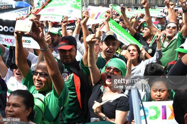 Mexican fans support their team during 2018 FIFA World Cup Russia group F match against Korea Republic at Zocalo on June 23 2018 in Mexico City Mexico