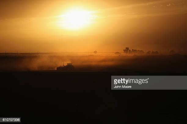 Mexican farm worker plows a US farm on September 27 2016 in Holtville California Thousands of Mexican seasonal workers legally cross the border daily...