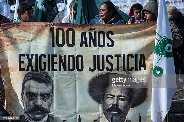 Mexican farmers hold a banner with faces of Emiliano Zapata and Pancho Villa during a protest by Agricultural Organizations to demand justice for the...