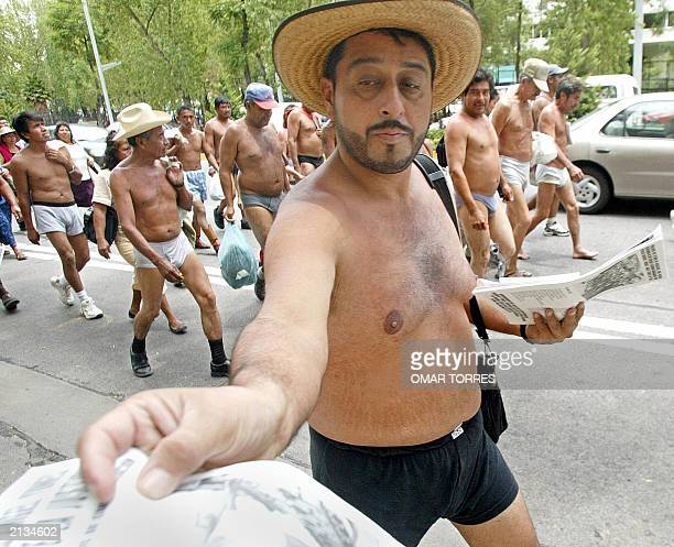 Mexican farmers representing the Farmers Movement of 400 Towns from the state of Veracruz march in protest in their underwear through the streets of...