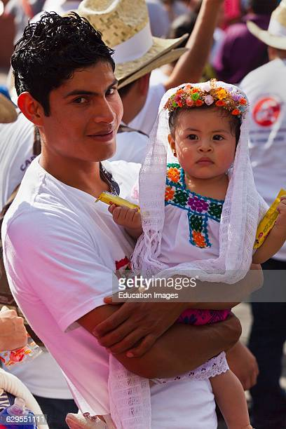 A Mexican Father Baby Dressed Traditionally In A Parade During The July Guelaguetza Festival Oaxaca Mexico