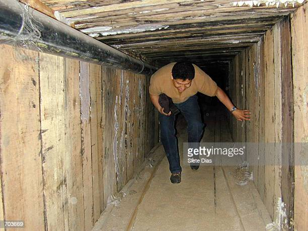 Mexican Federal Agent checks the interior of a tunnel discovered February 28 2002 that was used to transport drugs between Mexico and California The...