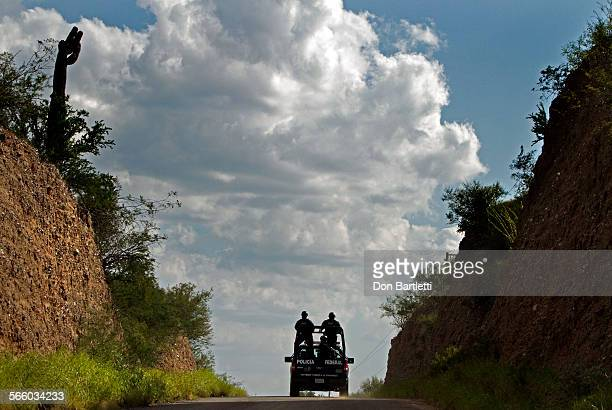 OCTOBER 6 2010 TUBUTAMA SONORA MEXICO Mexican Federal Police drive through enemy territory south of the Arizona border From the high embankments on...