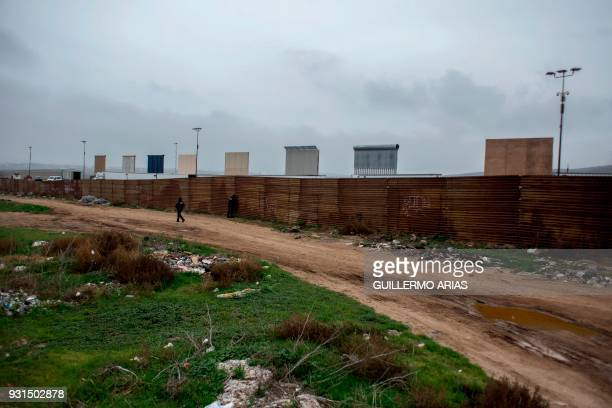 Mexican Federal Police officers patrol the Mexican side of the MexicoUS border in Tijuana Baja California state from where prototypes of the border...