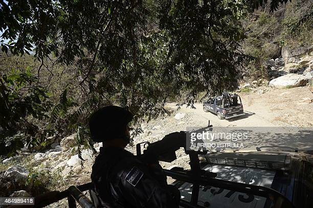 Mexican federal police patrol Arteaga town in Michoacan State Mexico on March 2 2015 Mexican police captured Knights Templar drug cartel's leader...