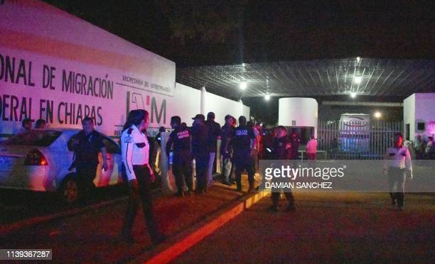 Mexican Federal police stand guard at an immigration detention center after a group of mainly Cuban migrants escaped in Tapachula Chiapas Mexico on...