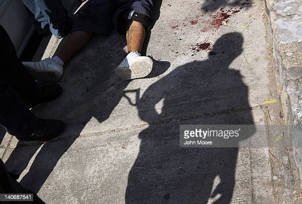 Mexican federal policeman stands guard at a suspected drugrelated execution on March 4 2012 near Acapulco Mexico Drug violence has surged in the...