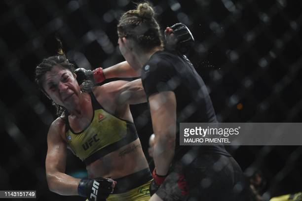 TOPSHOT Mexican fighter Irene Aldana competes against Brazilian fighter Bethe Correia during their women's bantamweight bout at the Ultimate Fighting...
