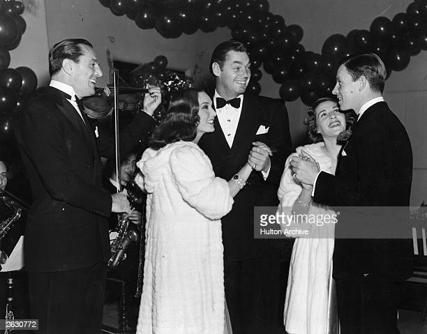 Mexican film actress Lupe Velez is dancing with Johnny Weissmuller and actor dancer and politician George Murphy