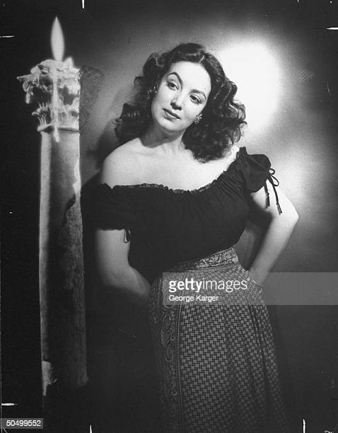 Mexican film actress Maria Felix posing seductivly
