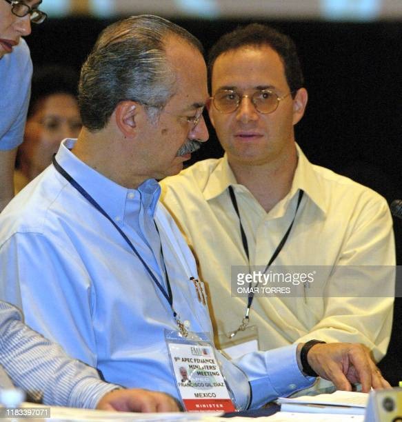 Mexican Finance Minister Francisco Gil speaks to his Director of Foreign Affairs Moises Schwartz during the opening session of the 9th Finance...