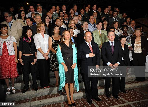 Mexican first lady Margarita Zavala Mexican President Felipe Calderon Colombian President Alvaro Uribe and Colombian First Lady Lina Moreno pose for...
