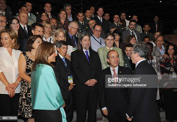 Mexican first lady Margarita Zavala Mexican President Felipe Calderon and Colombian President Alvaro Uribe talk before an official photo with a group...