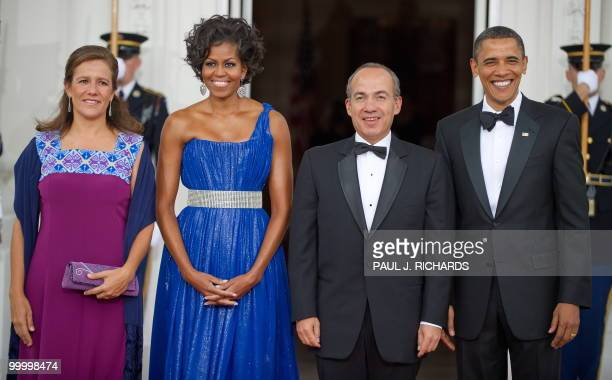 Mexican First Lady Margarita Zavala US First Lady Michelle Obama Mexican President Felipe Calderone and US President Barack Obama turn to the cameras...