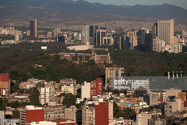 A Mexican flag flies on top of Chapultepec castle in this aerial photograph taken from a helicopter in the Condor Group a fleet of helicopters...