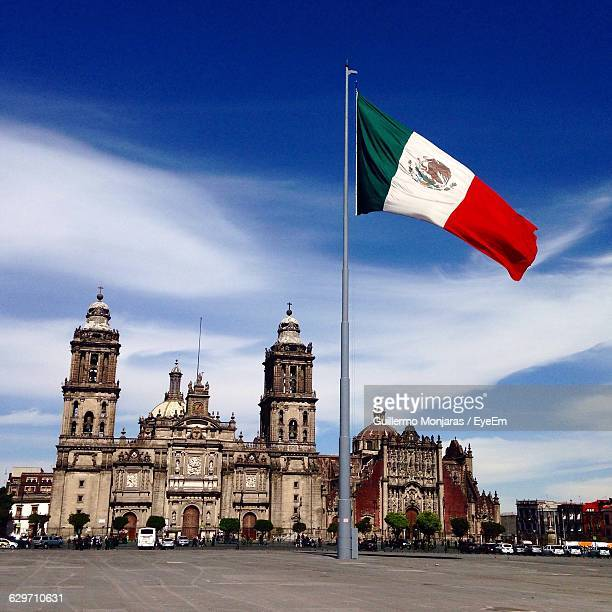 mexican flag waving at zocalo - mexico city stock pictures, royalty-free photos & images