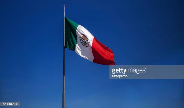 Mexican flag with blue sky