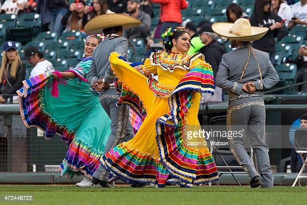 Mexican folk dancers perform for Cinco de Mayo celebrations before the game between the San Francisco Giants and the San Diego Padres at ATT Park on...
