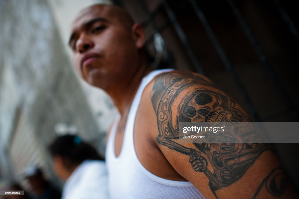 A Mexican follower of Santa Muerte shows his tattoo during