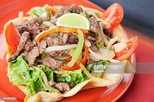 Mexican food: steak fajita salad in a crisp chalupa shell