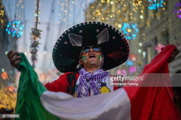 Mexican football fan enjoys the World Cup party atmosphere on Nikolskaya Street near Red Square on June 17 2018 in Moscow Russia Today saw the first...