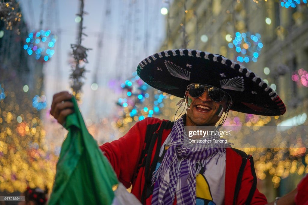 A Mexican football fan enjoys the World Cup party atmosphere on Nikolskaya Street, near Red Square on June 17, 2018 in Moscow, Russia. Today saw the first shock result of the tournament with Mexico beating Germany 1-0.