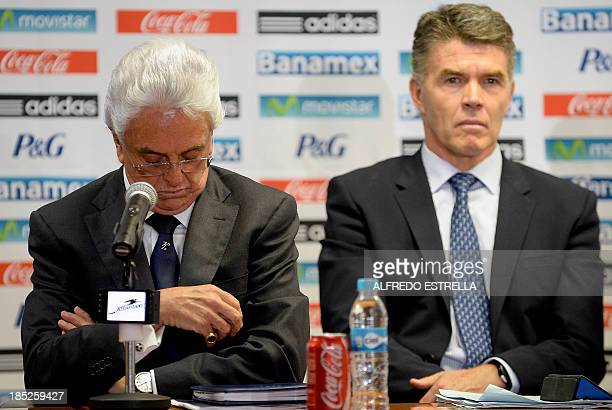 Mexican Football Federation president Justino Compean accompanied by the director of the country's national teams Hector Gonzalez Inarritu gestures...