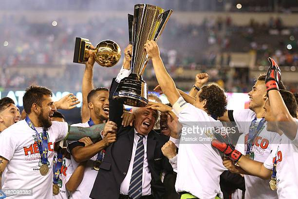 Mexican Football Federation president Justino Compean and team Mexico celebrate after defeating Jamaica in the CONCACAF Gold Cup Final at Lincoln...